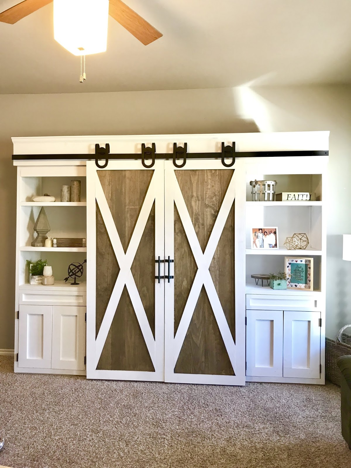 Barn door entertainment unit hide TV