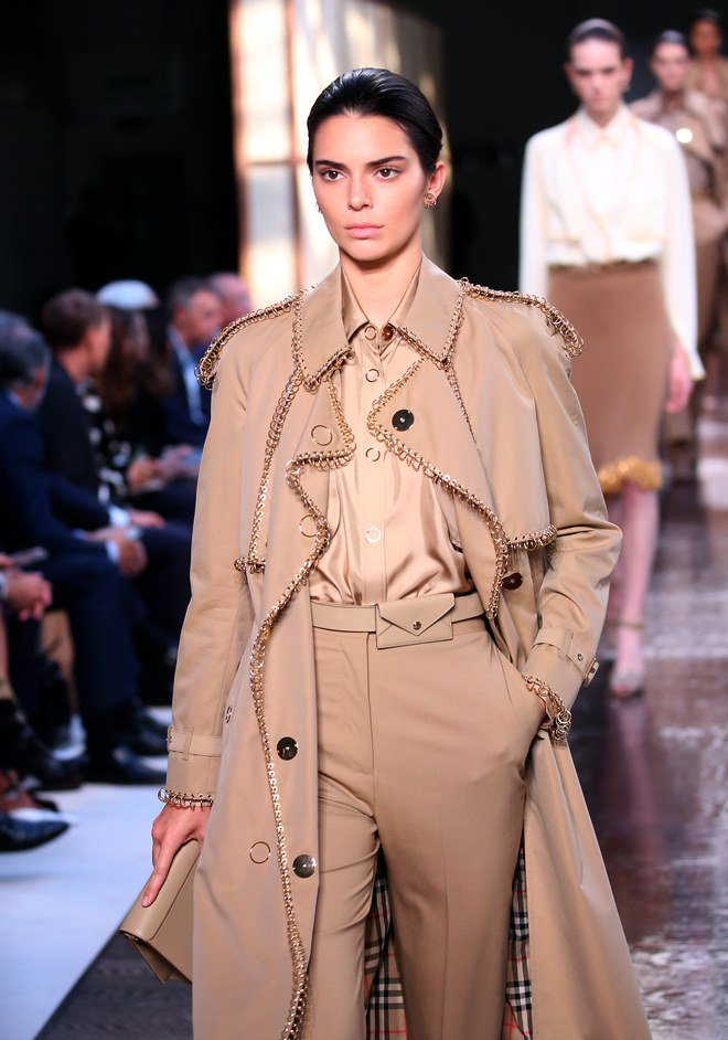 Kendall Jenner walks in her very FIRST show of fashion month as she struts her stuff for Burberry in London - and is even rewarded with a SMILE from Anna Wintour
