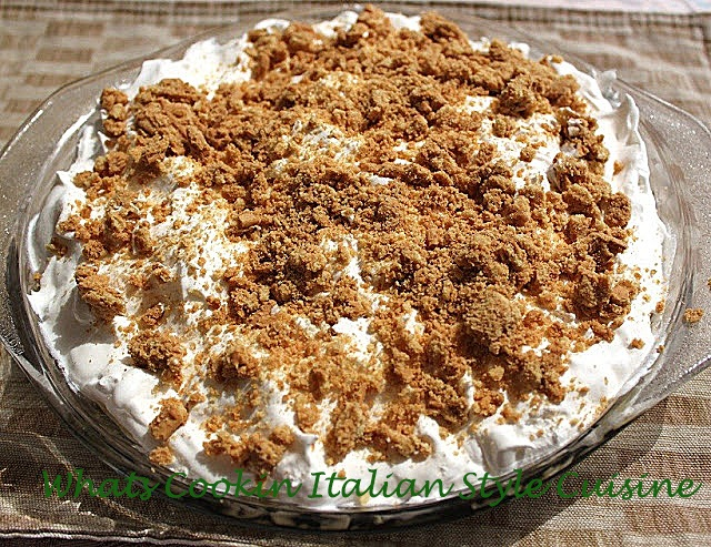 this is a chocolate cream classic pie with graham cracker crust and crumbs on top with fluffy whipped homemade cream