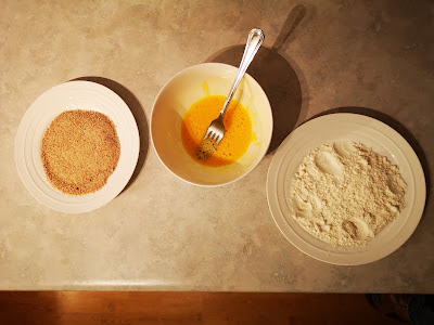 From left to right, bread crumbs, whipped egg and flour