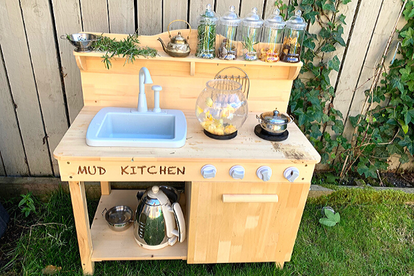 mud kitchen with working sink plastic jars and real teapot