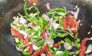 Stir frying vegetables like capsicum, bell peppers and onions for chicken hakka noodles recipe