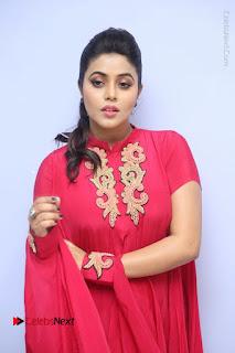 Actress Poorna Latest Stills in Red Dress at Rakshasi First Look Launch  0129.JPG