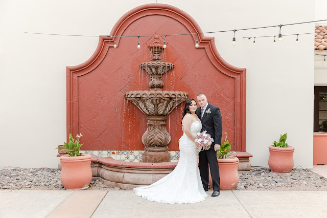 AZ Golf Resort Courtyard area with wall fountain and bride and groom portraits