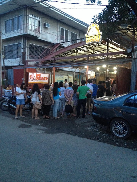 People line up before store opening at Yakski Barbecue