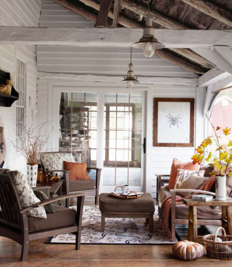 Cozy porch to sit on (from Country Living) | Friday Favorites at www.andersonandgrant.com