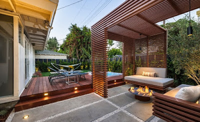 Terrace Decorating with the wooden slats floor tiles and fireplace