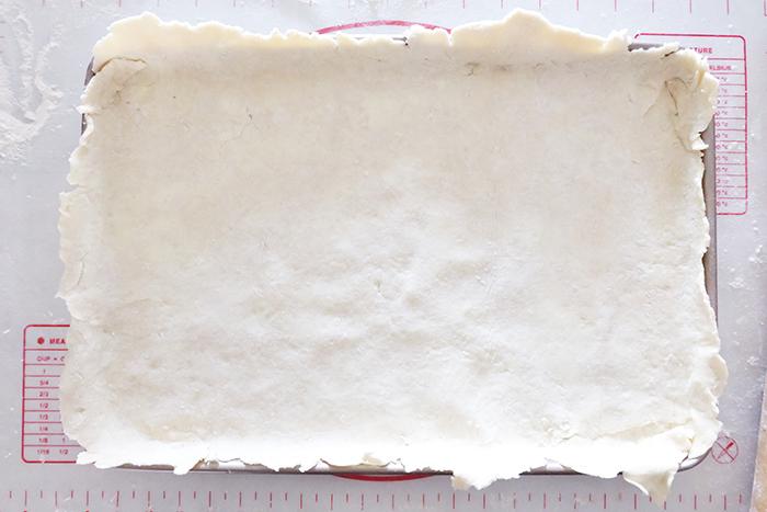 bottom crust dough in baking sheet