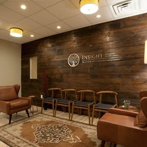 Cool Waiting Room With Wood Accent Wall