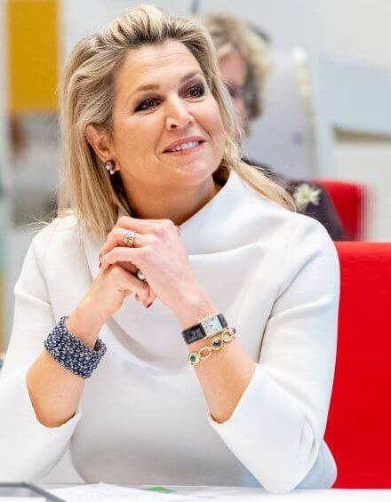 Queen Maxima wore a white silk top from Natan, and grey suede pumps from Gianvito Rossi, and the queen carried grey bag from Chanel