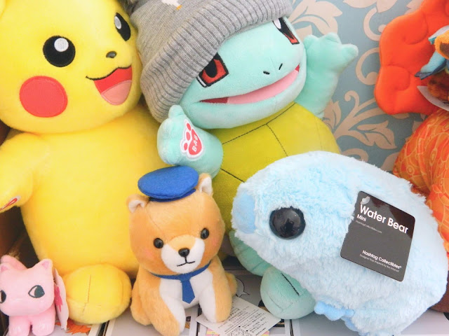 A selection of kawaii plush toys, ranging from pokemon to a water bear plush from Firebox