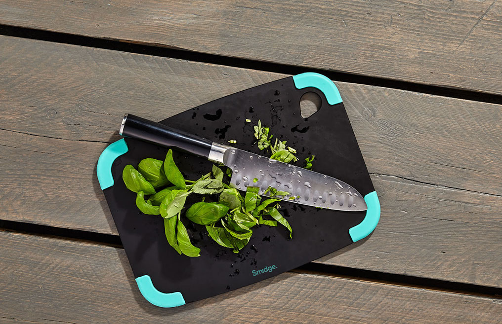 Chopped basil on a sustainably sourced chopping board from Smidge