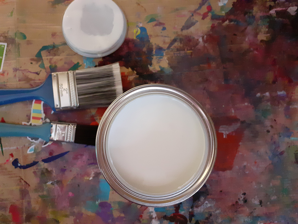 Open tin of white paint