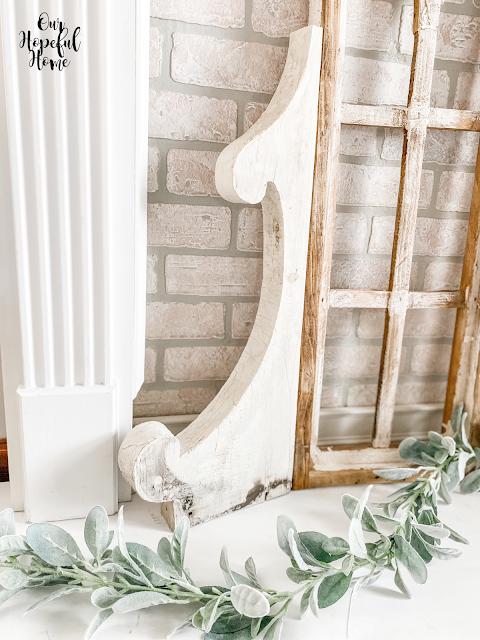 white column faux fireplace brick wall corbel