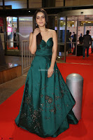 Raashi Khanna in Dark Green Sleeveless Strapless Deep neck Gown at 64th Jio Filmfare Awards South ~  Exclusive 080.JPG