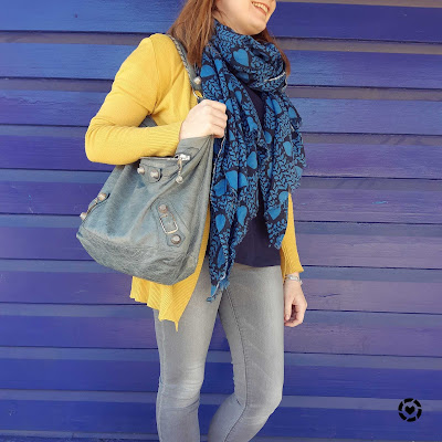 awayfromblue Instagram | mustard cardigan with navy tee heart print scarf grey skinny jeans and Balenciaga tempete day hobo bag