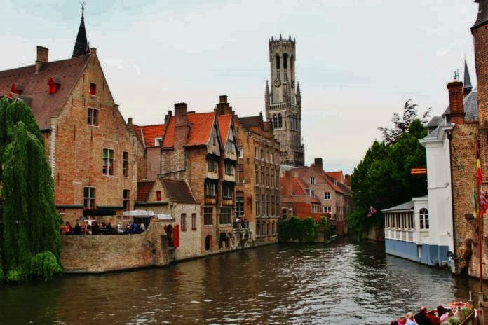 Canal in Bruges with Belfry in the background
