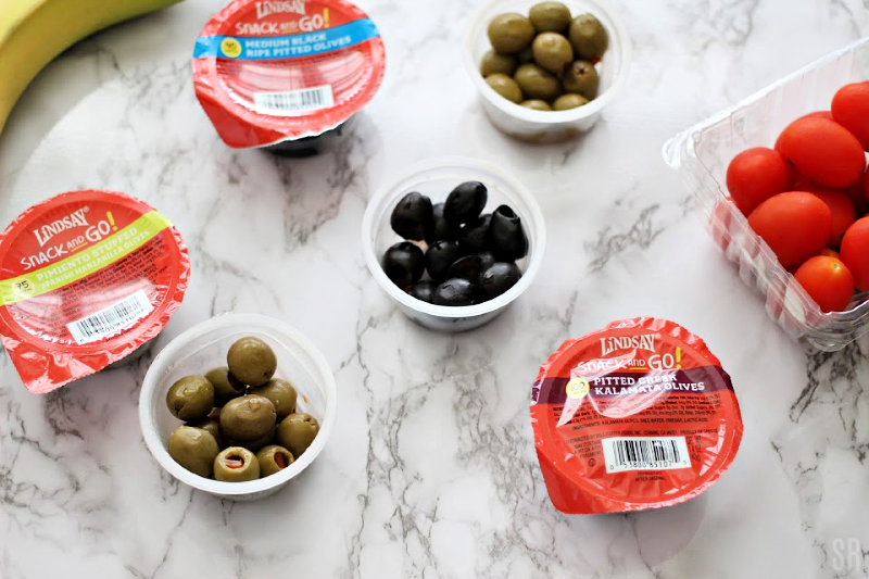 olives and fruit on a marble table