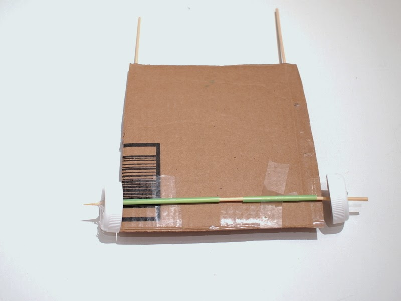 attach wheels to cardboard car
