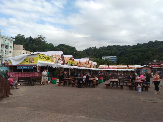 Tables and stands selling food at Parque Vila Germanica