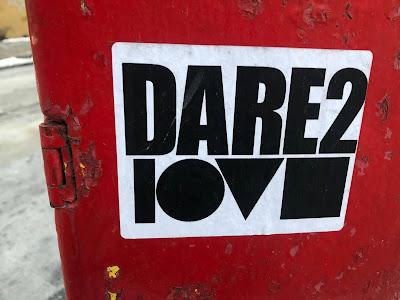 "Sticker saying ""Dare 2 Love"""