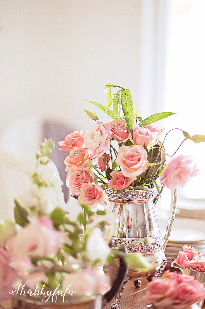 blush pink roses in a silver coffee pot