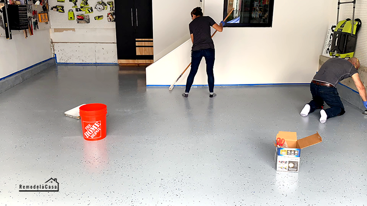 Applying top coat to epoxy garage floor