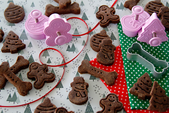 Homemade carob Christmas dog treats with plunger cookie cutters