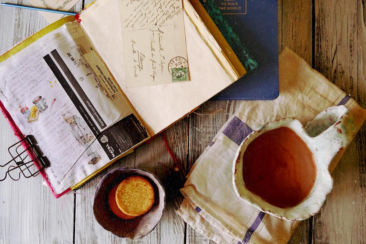 sketchbook and coffee, making winter