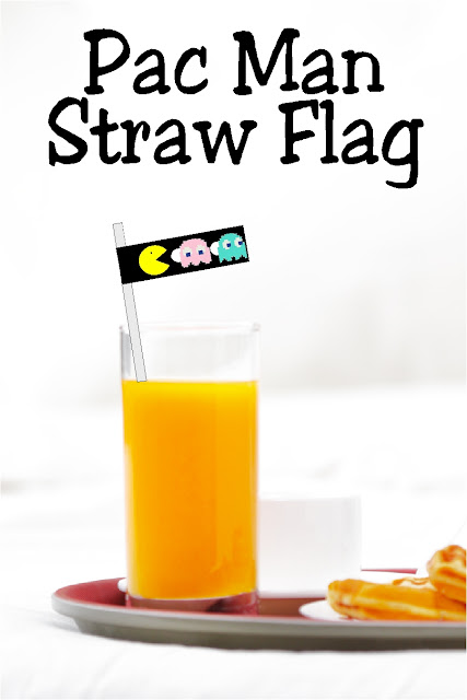 Dress up your straws with a fun party decoration perfect for your Arcade Video game party.  This free printable is an easy way to add a little bit of Pac Man fun.  #arcadeparty #videogameparty #pacman #80sparty #diypartymomblog