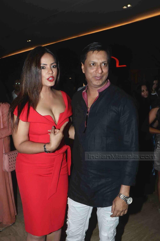 Neetu Chandra snapped with Madhur Bhandarkar at a movie
