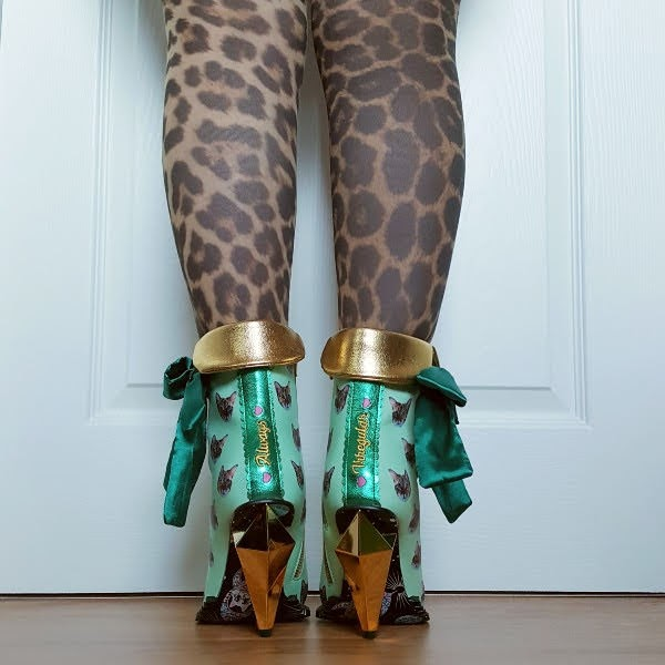 Always Irregular embroidered spine on boots with gold jewel like heel