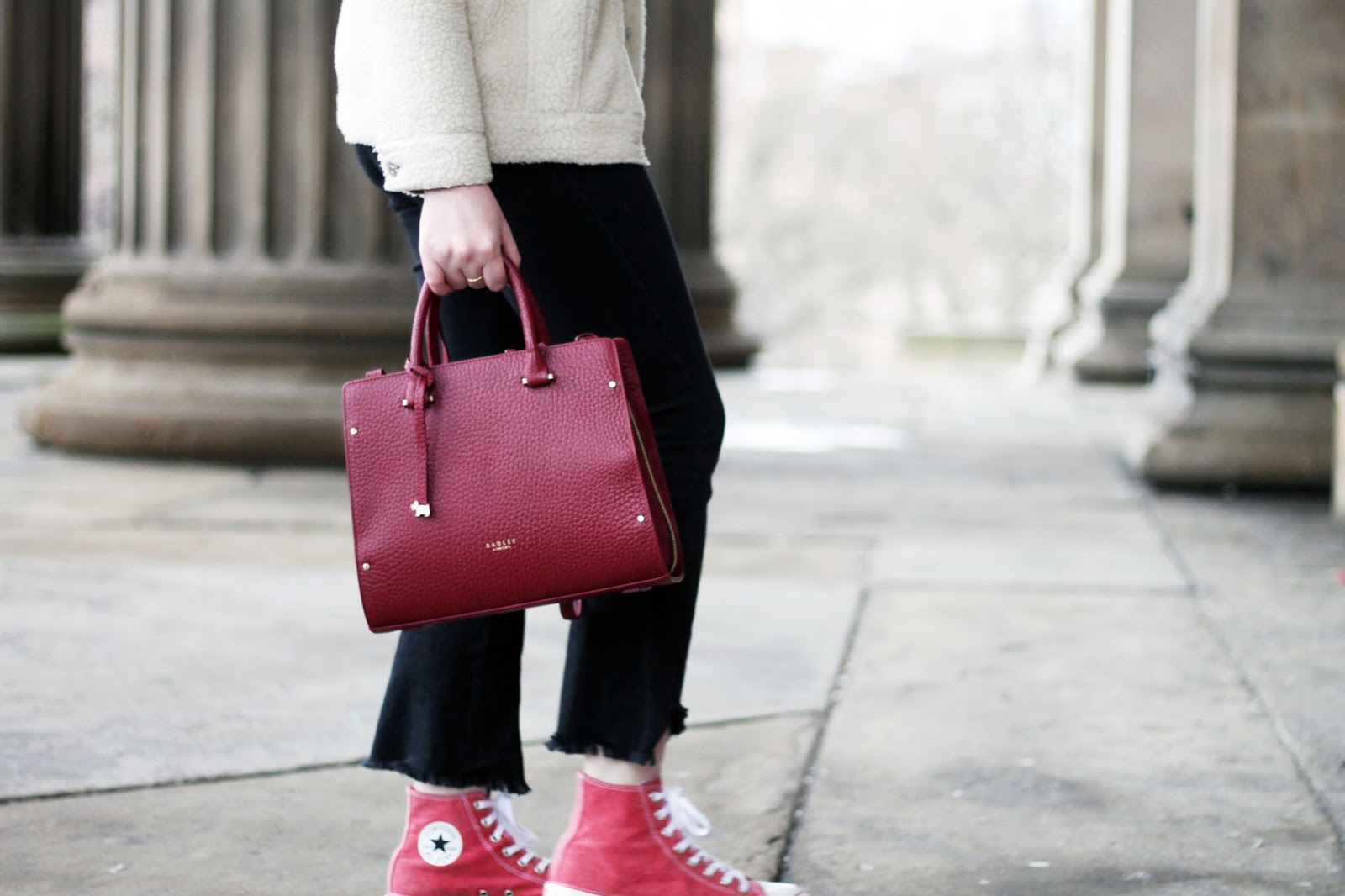 Burgundy leather bow lane handbag and washed red high top converse