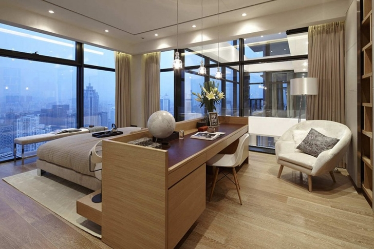 Working desk in the bedroom of Modern apartment in Shenzhen by Kokai Studio