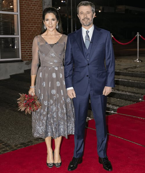 Crown Princess Mary wore a new bespoke silk chiffon and metallic embroidery dress from Soeren Le Schmidt, and aquamarine girandole earrings