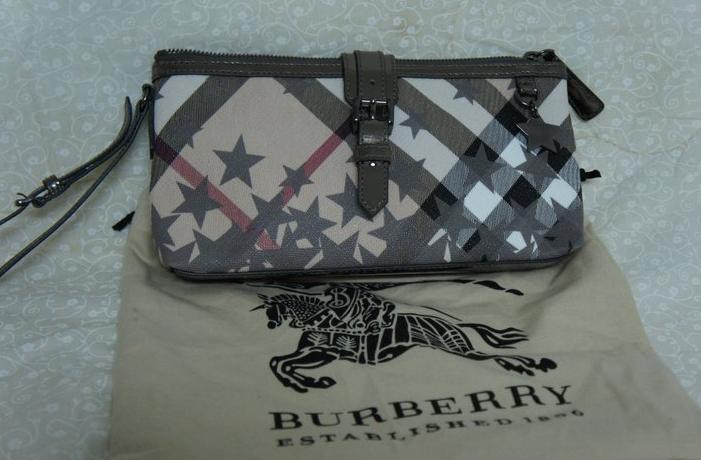cd65a5449577 Burberry Nova wristlet clutch bag with stars design in dark silver  trimming