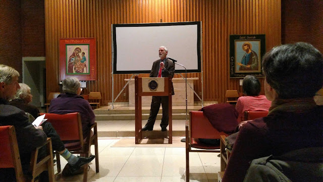 A photo of Michael O'Brien during his talk at the chapel at Regis College.
