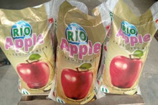 The image of 3 Rio apple parboiled rice 50kg on the same basement