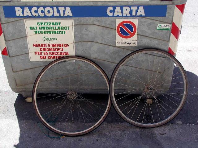 Paper only dumpster with two bicycle wheels, Livorno