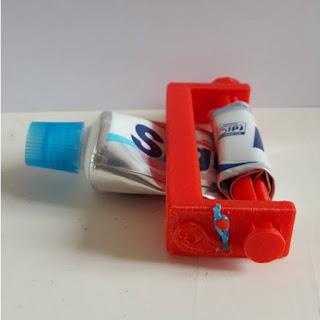 Diş macunu sıkma aparatı