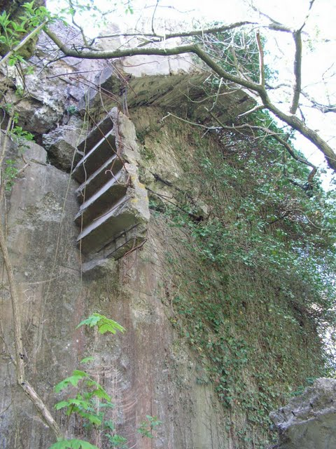 Concrete stairs hanging from steel bars at Battery Todt
