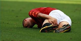 jogador lesionado na coxa