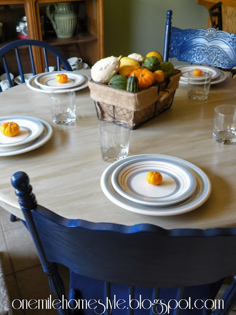 Fall table setting on cream table with nave blue chairs