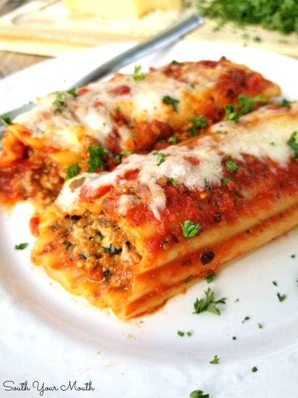 Italian Sausage & Cheese Baked Manicotti! An easy recipe for classic, meaty baked manicotti stuffed with Italian sausage and cheese.