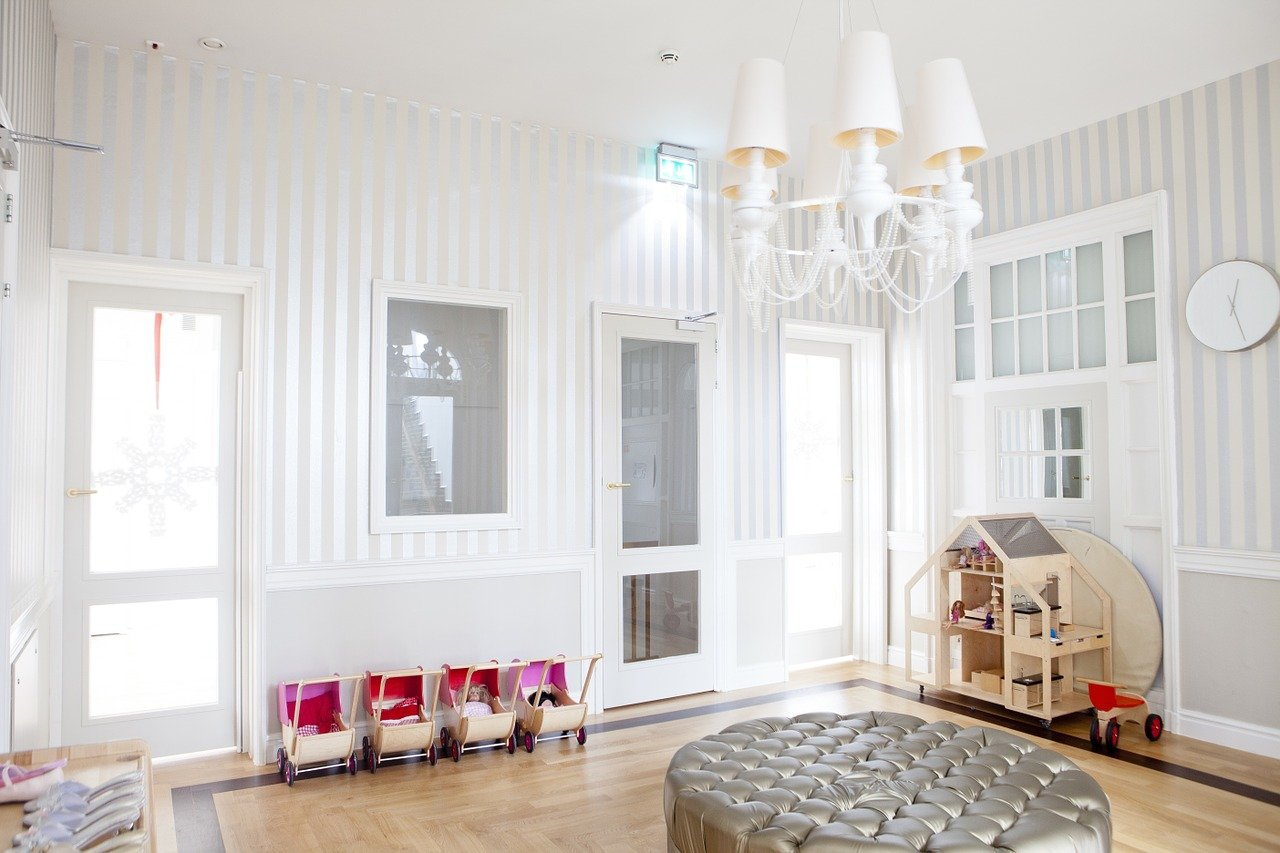 A stylish looking playroom in a white and grey house
