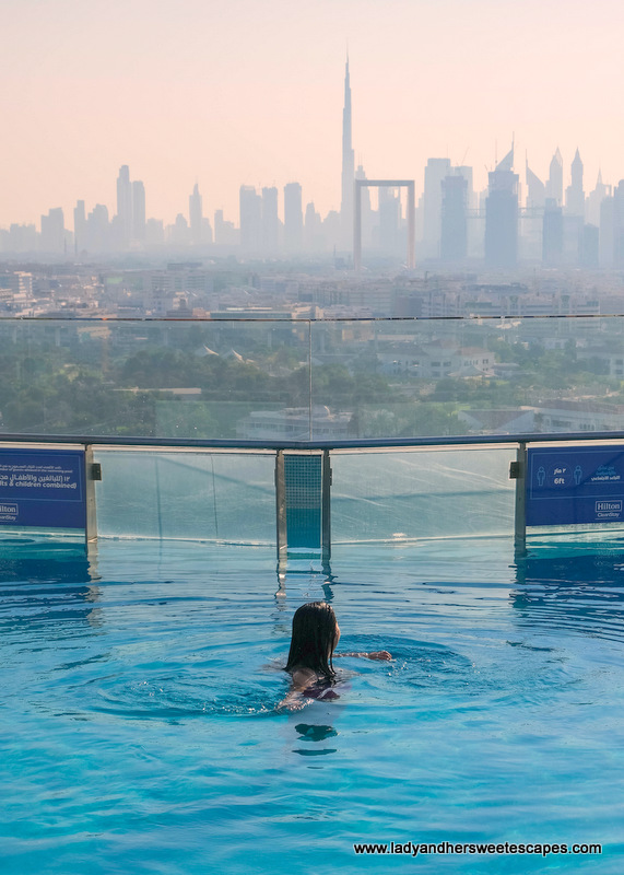 Lady in Hilton Dubai Creek Hotel rooftop pool