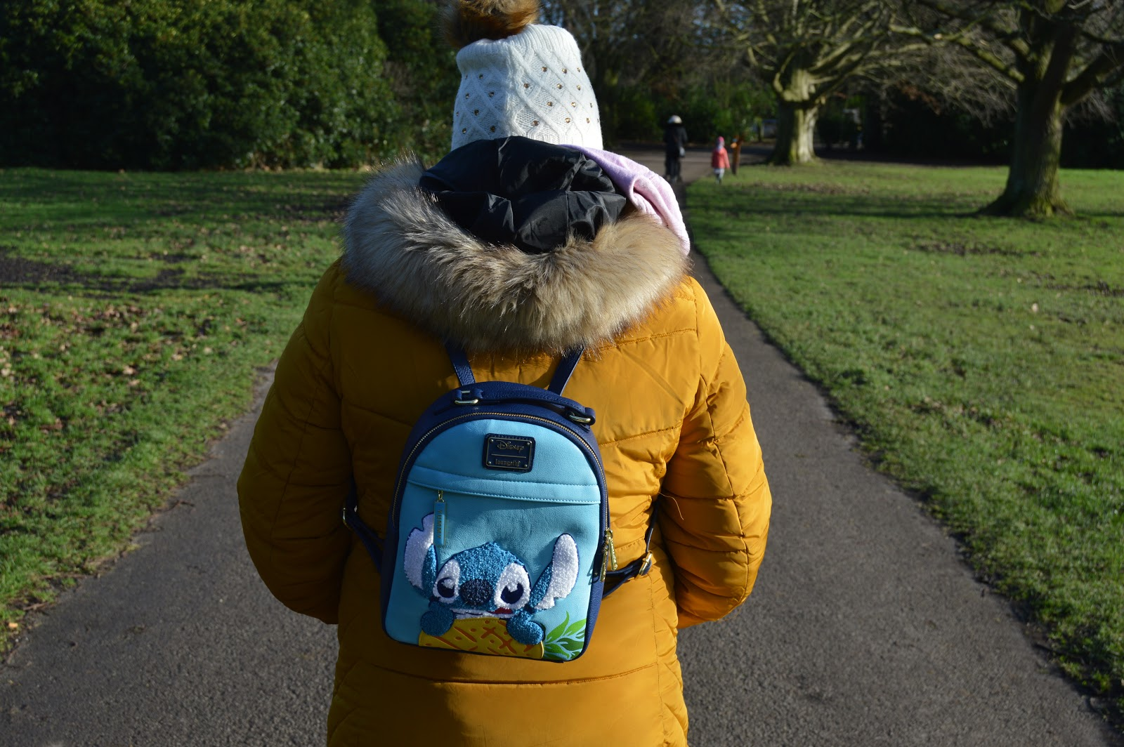 lady wearing a loungefly stitch backpack