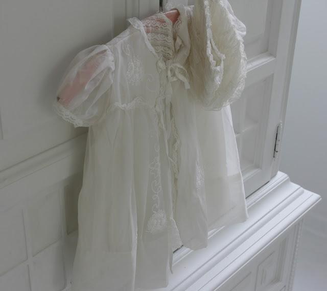 Vintage white Christening gown on dresser - Hello Lovely Studio