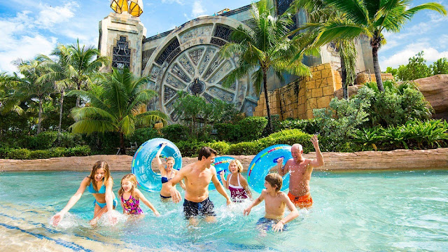 a family enjoys at Aquaventure Waterpark