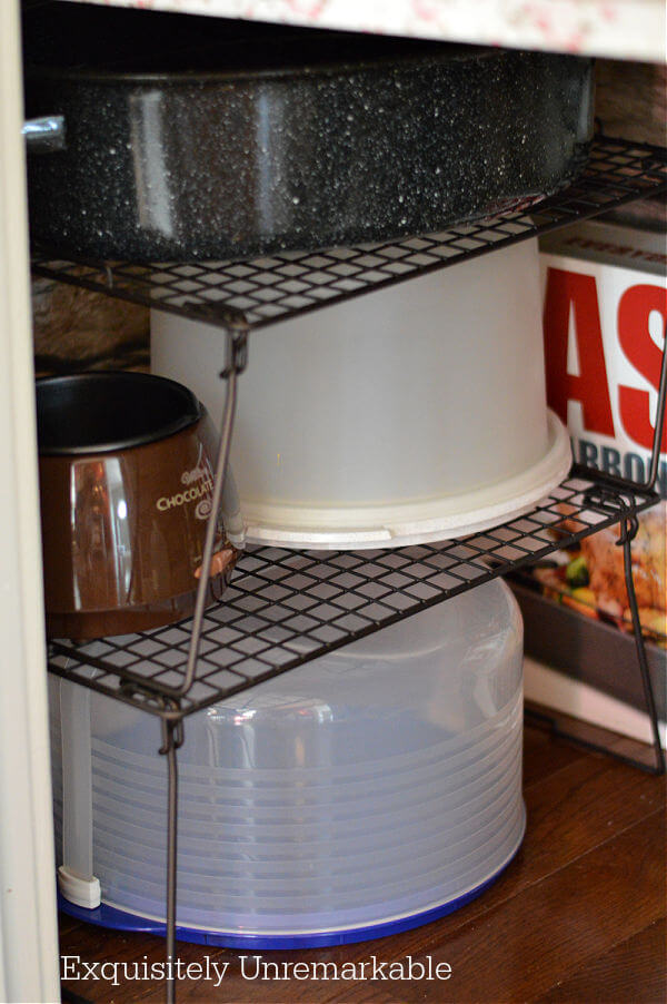 Stackable Wire Shelves on floor of pantry with cake keepers on top